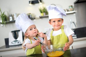 Top 5 ways hospitality uniforms benefit young chefs cooking kids clothing